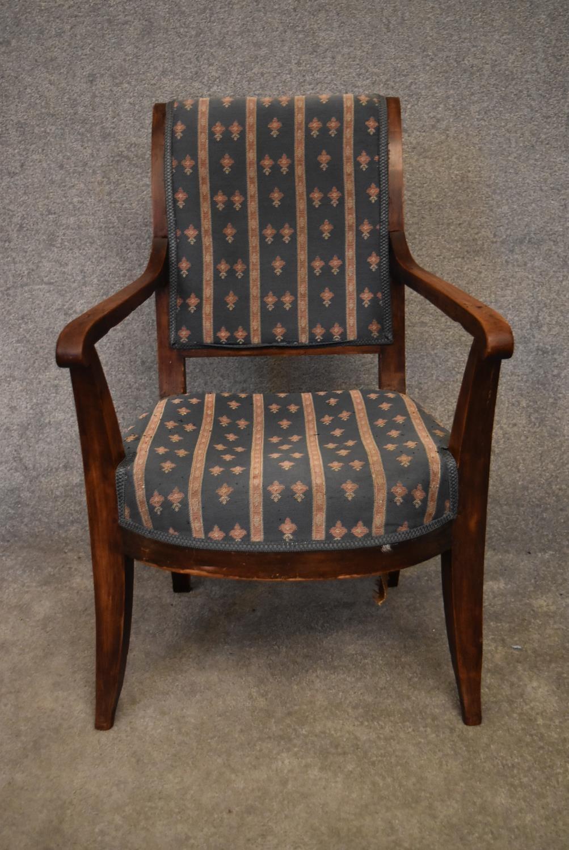 A Continental elm framed Empire style armchair. H.90x55cm