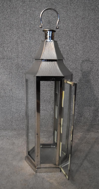 A tall metal framed storm lantern. H.88cm - Image 3 of 3