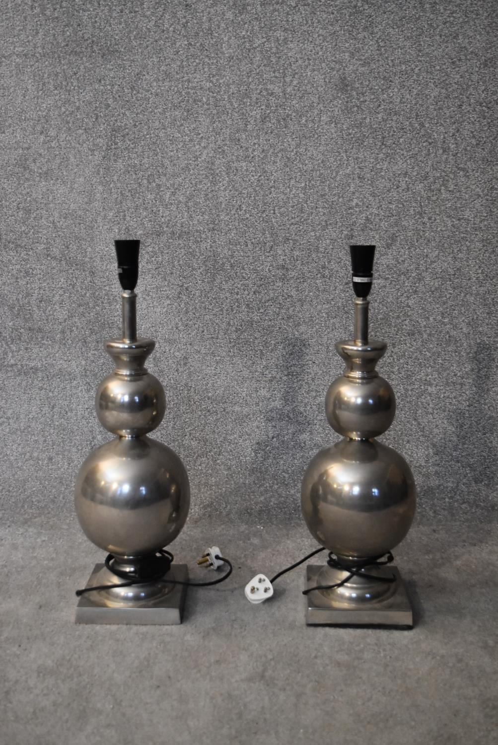 A pair of metal double gourd shaped table lamps. H.60cm