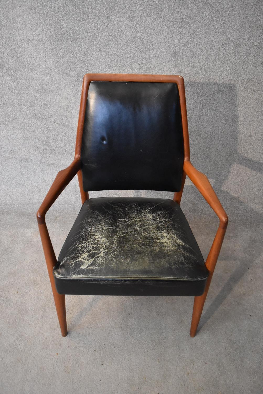 A mid 20th century vintage Danish teak framed armchair in leather upholstery. H.98x60cm - Image 2 of 4