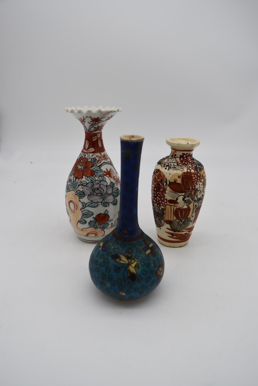 Three hand painted porcelain vintage Oriental vases. One decorated with a floral design, a ruffled