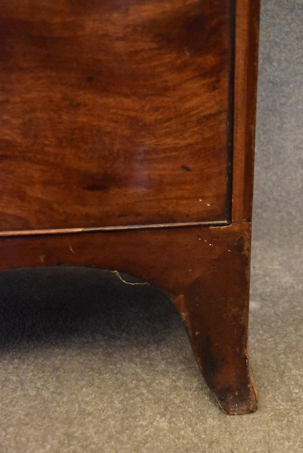 A Georgian mahogany and satinwood inlaid bowfronted chest of drawers on swept bracket feet. H. - Image 4 of 4