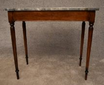 A 19th century mahogany console table with grey marble top on reeded tapering supports. H.75x82x43cm