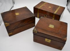 A 19th century brass bound walnut writing slope and two other similar boxes. H.15x35cm