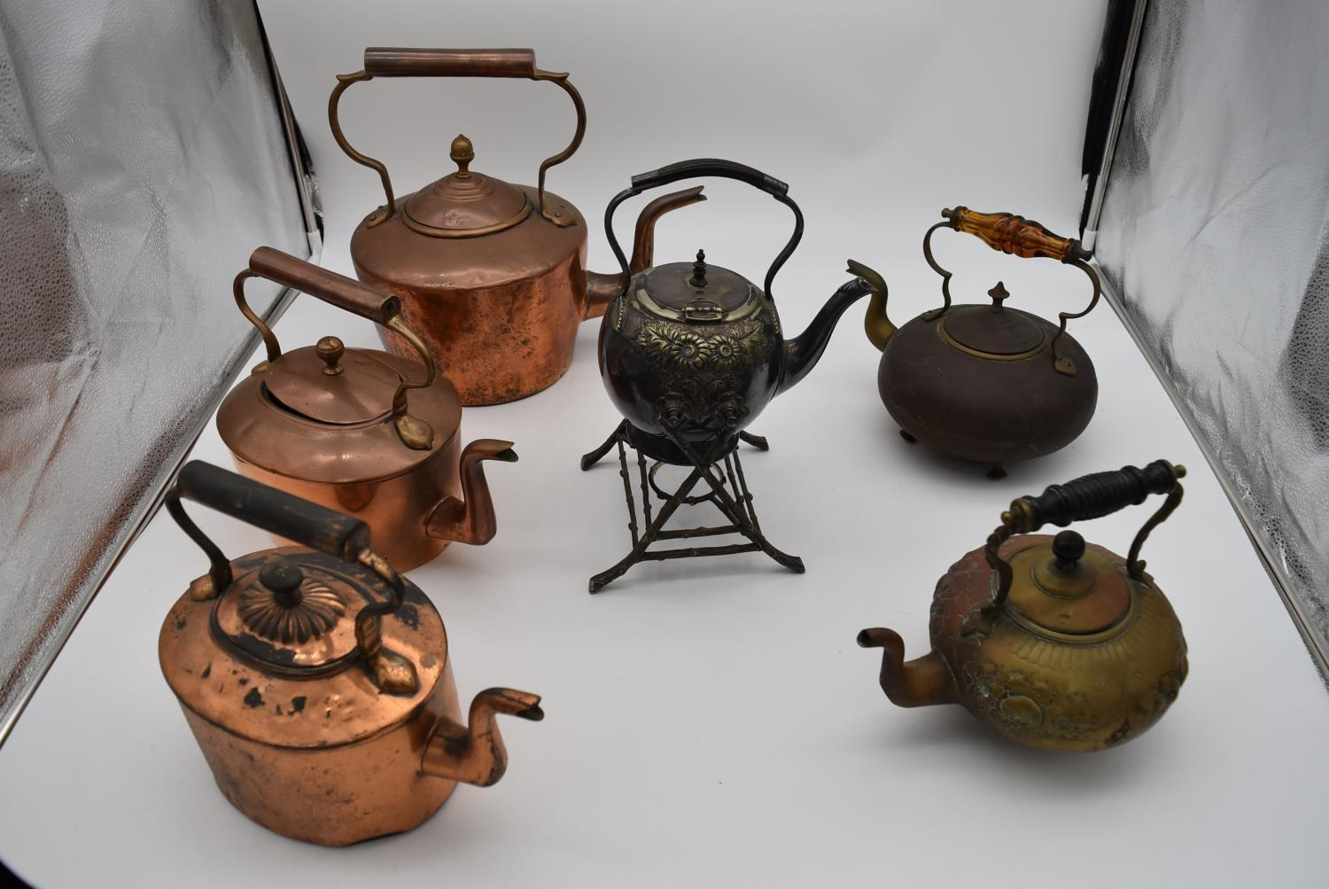 A 19th century silver plated spirit kettle on stand and a collection of five copper and brass