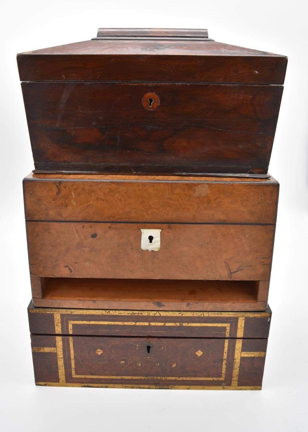 A 19th century burr walnut fitted vanity box (drawer missing) with mother of pearl shield shaped