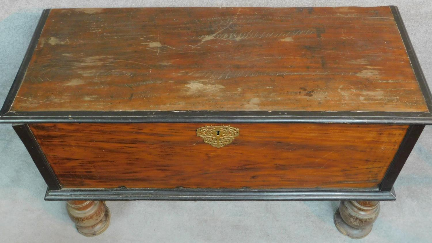 A 19th century Continental ebonised and fruitwood coffer with fret cut brass escutcheon, hinged - Image 2 of 11