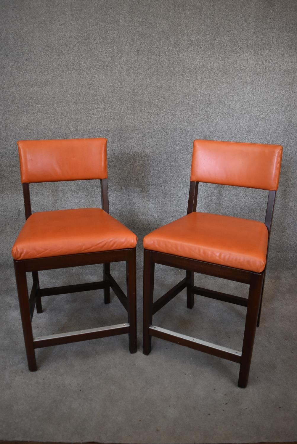 A pair of leather upholstered teak framed high stools. H.100x55cm