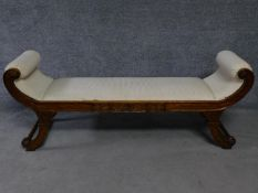 A Regency style mahogany window seat on swept supports. H.65 W.165 D.48cm