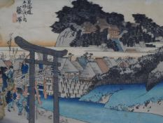 An antique coloured woodblock print from the '53 Stations of the Tokaido' series by Hiroshige.