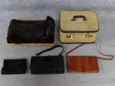 A collection of vintage bags, one alligator, a canvas and leather travelling jewellery case with