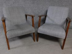 A pair of teak framed vintage style armchairs in grey upholstery. H.73cm