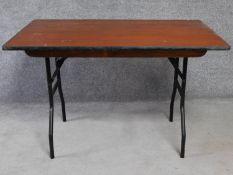 A metal framed folding trestle table. H.76 W.120 D.76cm