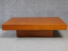 A contemporary teak rectangular coffee table on plinth base. H.38 L.140 W.90cm