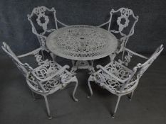 A metal Coalbrookdale style garden table and the matching four armchairs. H.68 W.80 D.80cm (table)