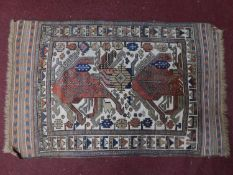 An Anatolian rug with ornate geometric design on ivory ground surrounded by multi geometric