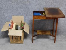 A mahogany foldover top card and compendium games table together with a collection of board games,