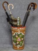 A hand painted umbrella stand together with six vintage umbrellas. H.45cm