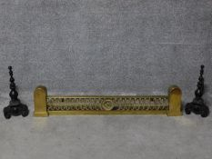 A 19th century brass fire kerb together with a pair of andirons. H.110cm