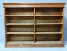 A 20th century walnut open bookcase on plinth base. H.124 W.177 D.42cm