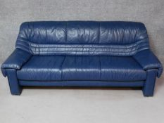 A contemporary World of leather three seater sofa in blue leather upholstery. H.80 W.205 D.83cm