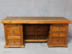 An Eastern teak pedestal desk with an arrangement of five drawers. H.78 W.179 D.59cm