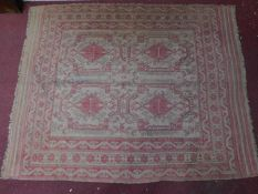 An Engsi style symmetrical rug on an ivory and rouge field surrounded by multiple geometric