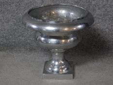 A vintage aluminium pedestal urn planter H.30 W.33 D.33cm