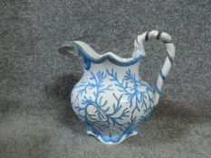 A Georgian hand painted ceramic serpent seaweed pitcher By E. Jones, Cobridge. Stamped to base '