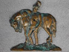 An antique bronze relief wall plaque of a soldier leaning on his horse. Indistinctly signed Jacques.