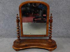 A 19th century walnut swing dressing mirror with original glass plate. H.66cm