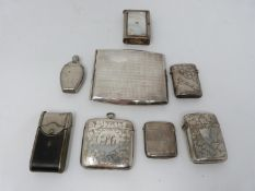 A collection of antique silver and metal vesta cases and a silver cigarette case. Including an