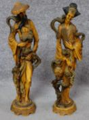 A pair of Chinese style moulded figures. H.49cm