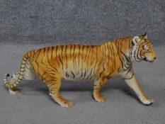 A Franklin Mint 'On The Prowl' porcelain hand painted striding tiger by George Mc Monigle .