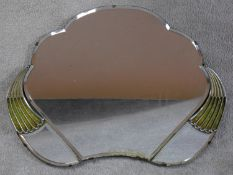 An Art Deco cloud shaped triple section mirror with bevelled glass and green bakelite detailing.