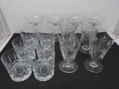 A collection of cut glasses, to include four champagne coupes, six whiskey tumblers and four crystal