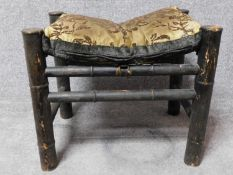 A Chinese bamboo stool on circular section stretchered supports. H.46 W.55 D.41cm