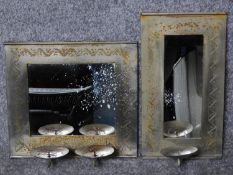 Two Eastern engraved metal wall mirrors fitted with candle sconces. 31x28cm (largest)