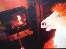 A surrelaist photographic print depicting a horse watching the television. 98x77cm