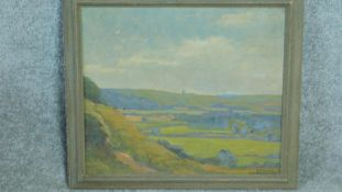 A framed oil on board by British artist Ethel Louise Rawlins (1880-1940), 'Sussex Downs', signed
