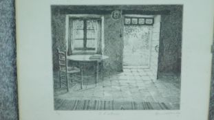 A glazed and signed etching by British artist Annie Williams, titled 'A L'Interieur'. Signed by
