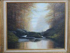 A gilt carved wood framed oil on canvas river landscape by british artist D. J. Lawrence. Titled'