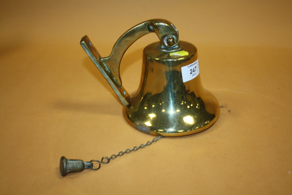 Lot 247 - A VINTAGE BRASS WALL MOUNTABLE BELL