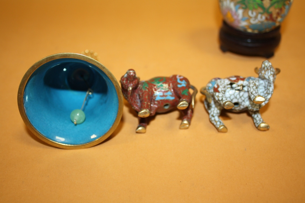 Lot 522 - AN ORIENTAL/ CHINESE CLOISONNE BELL, TOGETHER WITH TWO SMALL CLOISONNE CATTLE FIGURES AND AN EGG