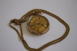 A LATE 19TH CENTURY CONTINENTAL LADIES FOB WATCH (marked 14ct) on a 9ct gold necklace chain.