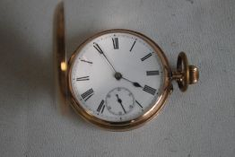 A 9ct GOLD GENTLEMAN'S FULL HUNTER POCKET WATCH (Unsigned) with white enamel dial, with black