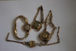 FOUR GOLD LADIES' WRISTWATCHES, to include a 14ct Benrus example on a plated strap (4)
