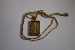 A 9ct GOLD ST CHRISTOPHER INGOT/PENDANT, on a fancy link chain