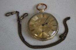 A YELLOW METAL GENTLEMAN'S OPEN FACE KEY WIND POCKET WATCH, gilt dial engraved with a scene of