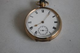 A GENTLEMAN'S 9ct GOLD OPEN FACED TOP WIND POCKET WATCH, white enamel dial with Roman Numeral